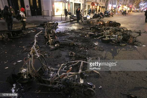 A picture taken on January 5 2019 at he SaintGermain boulevard in Paris shows scooters which were burned during a demonstration called by the yellow...