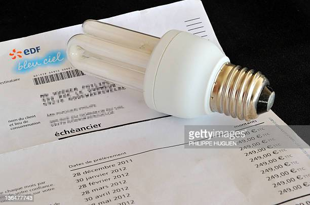 A picture taken on January 6 2012 in Godewaersvelde shows an energysaving lightbulb on a electricity invoice Recommendations by France's nuclear...