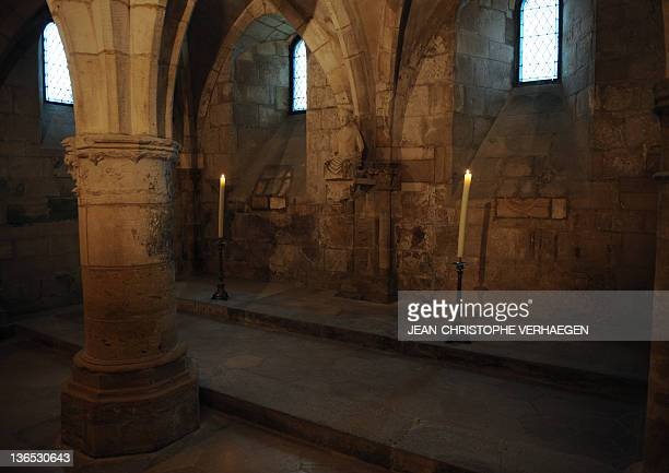 A picture taken on January 6 2012 shows a statue showing a Virgin ancient and deeply venerated called NotreDamedelaVoûte inside the crypt of the...