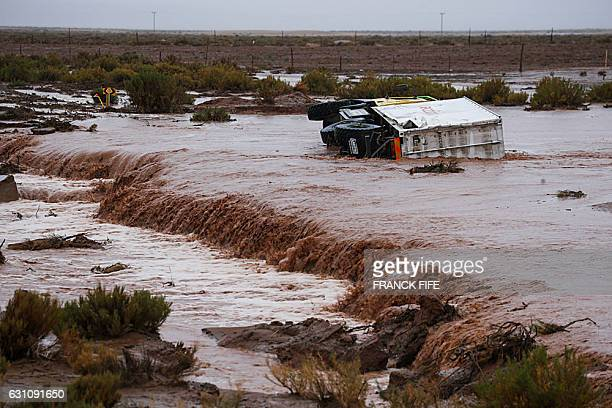 TOPSHOT Picture taken on January 6 2017 showing an assistance truck overturned due to the weather during the Stage 5 of the Dakar 2017 between Tupiza...