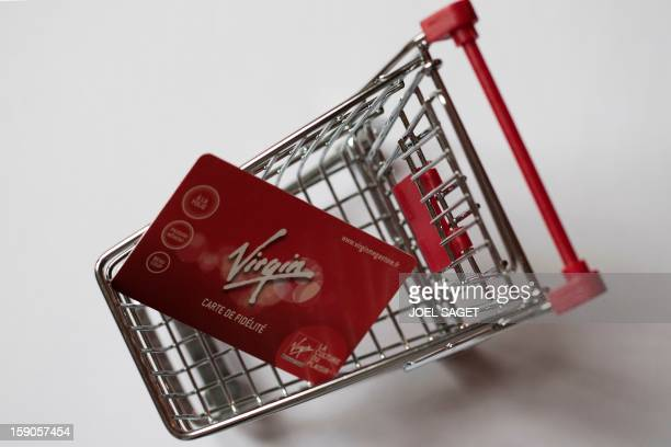 Picture taken on January 7 2013 in Paris shows an illustration made with a Virgin Megastore loyalty card in a miniature toy shopping cart The Virgin...