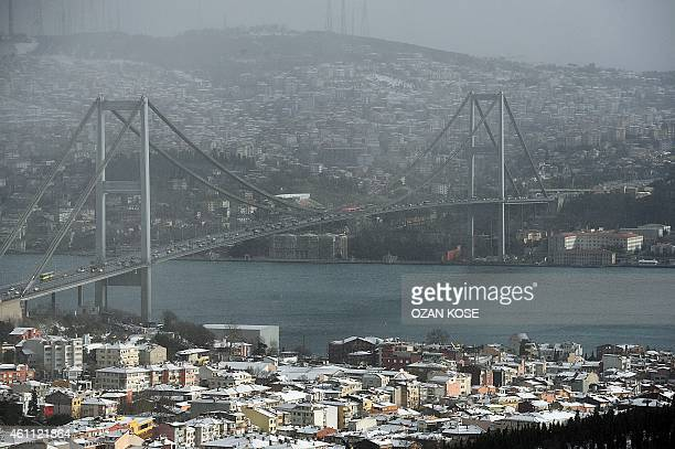 A picture taken on January 7 2015 shows the Bosphorus bridge as snow falls in Istanbul Heavy snowfall descended on large parts of Turkey on January 6...