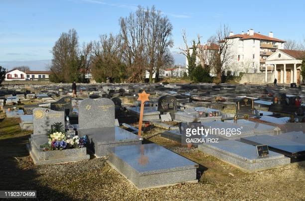 A picture taken on January 7 shows a general view of the Jewish cemetery of Bayonne southwestern France where a dozen graves have been desecrated a...