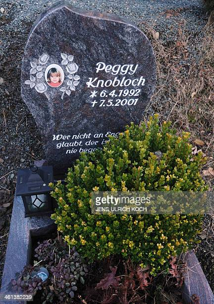Picture taken on January 8 2014 at the cemetery in Nordhalben near Kronach southern Germany shows the portrait of alleged murder victim Peggy...