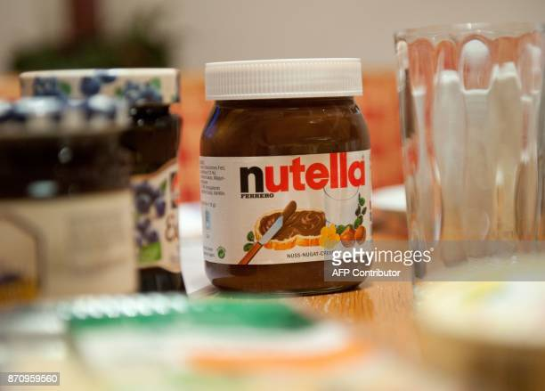 A picture taken on January 8 2014 shows a pot of Italian hazelnut and cocoa spread 'Nutella' on a breakfast table in Inzell Germany The maker of the...