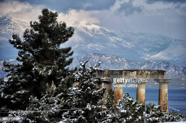 A picture taken on January 8 2017 shows the archaeologicial site of Ancient Corinth with the Temple of Appolon is covered by snow in Ancient Corinth...