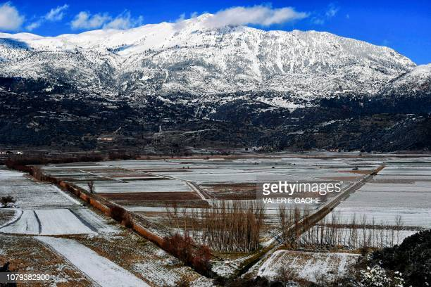 A picture taken on January 8 2019 shows the Lake Stymphalia a wetlands area in Corinthia southern Greece following a snowfall