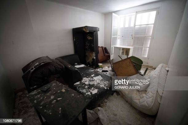 A picture taken on January 8 2019 shows the living room of a squat where medical staff tried to save 17yearold Wilson Mendes who was shot dead with a...