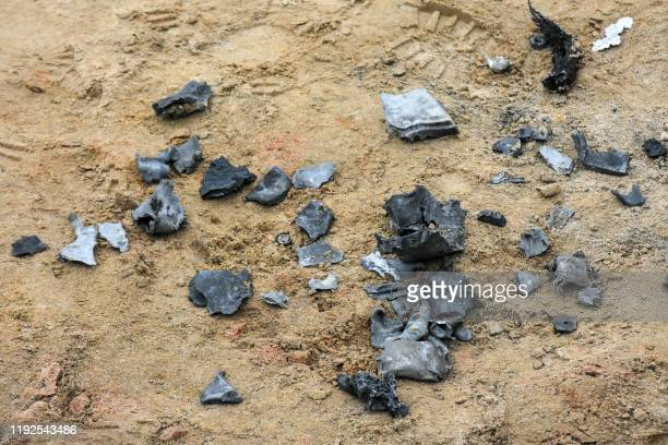 A picture taken on January 8 2020 in the Iraqi Kurdish town of Bardarash in the Dohuk governorate shows shrapnel from a reportedly Iranian missile...