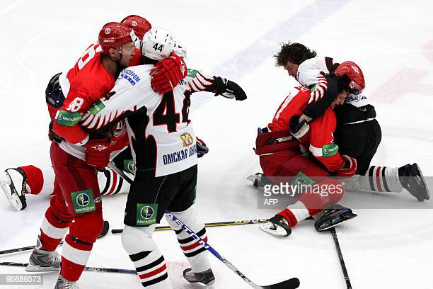 Picture taken on January 9 2010 shows hockey players Alexander Romanov and Darcy Verot of Vityaz Chekhov fighting with Timofei Shishkanov and Jaromir...