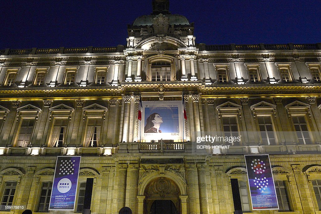 A picture taken on January 9, 2013 shows the effigy of a new stamp published by French postal services La Poste, displayed on the facade of the regional prefecture in Marseille, southern France, ahead of the 2013 'Marseille-Provence European Capital of Culture', starting on January 12. The effigy represents the face of the European Capital of Culture.