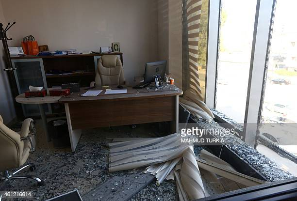 A picture taken on January 9 2015 shows glass debris in an office at the alNabaa News Channel head office that was hit by a rocket attack in the...