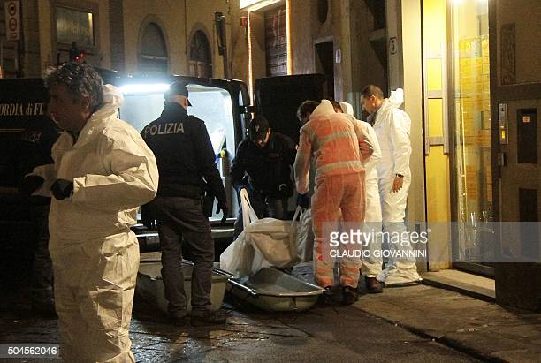 Picture taken on January 9, 2016 shows police officers and forensics carrying the body of Ashley Olsen, a 35-year-old American expatriate artist who...