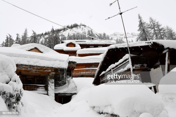 A picture taken on January 9 2018 shows chalets covered with snow in the center of Val d'Isere village in the French Alps following the reopening of...