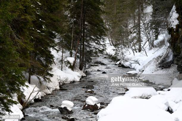 A picture taken on January 9 2018 shows the river Isere that takes its source in the Parc de la Vannoise covered in snow in Villaroger near Val...
