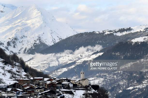 A picture taken on January 9 2018 shows the village of Villaroger in the middle of the mountains covered in snow near Val d'Isere in the French Alpes...