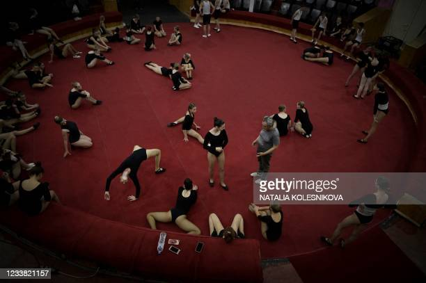 Picture taken on July 1, 2021 shows applicants getting ready as they wait for their turn to perform in front of the selection committee during the...