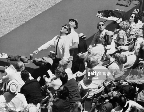 Picture taken on July 10, 1962 of US President, John Fitzgerald Kennedy, raising from his seat to watch the flight of the ball during All Star...