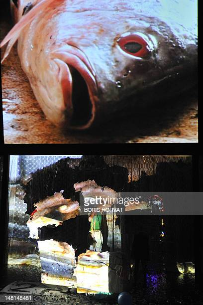 A picture taken on July 10 2012 shows a video screen on stage as actors of the Mapa Teatro from Bogota perform during a rehearsal of the play Los...