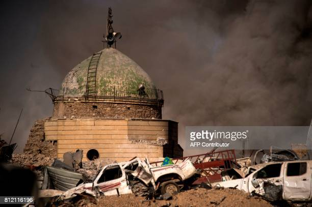 A picture taken on July 10 shows smoke plumes billowing in the Old City of Mosul during the offensive by the Iraqi force to retake the embattled city...