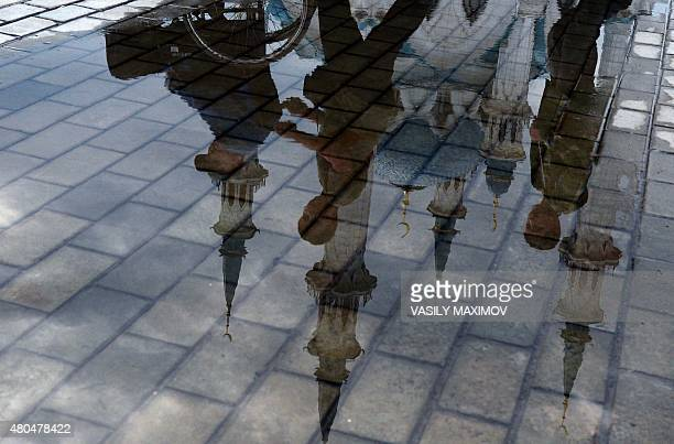 A picture taken on July 11 2015 shows the reflection of the main mosque Qol Sharif in the Kremlin in Kazan the capital of Russia's Muslim autonomic...