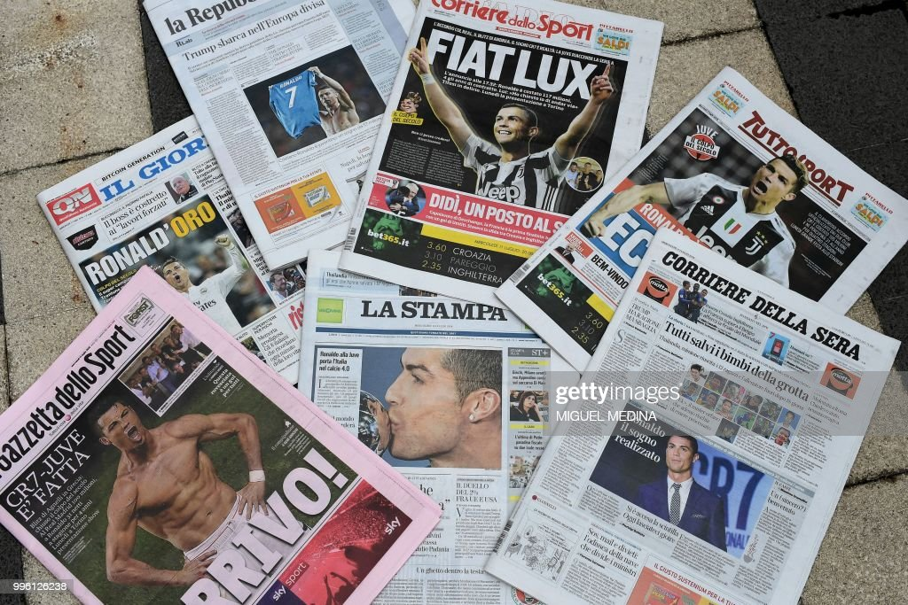A picture taken on July 11, 2018 in Milan shows the Italian newspapers front pages enlightening the arrival of Portugal's Cristiano Ronaldo at the Italian Serie A football club Juventus Turin. - Ronaldo left Real Madrid to join Italian champions Juventus for 100 million euros ($117 million) on July 10, with the Portuguese superstar saying the time had come 'for a new stage' in his life. Juventus confirmed that Ronaldo had signed a four-year contract and that the transfer fee, including 12 million euros in add-ons, would be paid over two years, with Spanish media reporting he would receive a salary of 30 million euros a season.