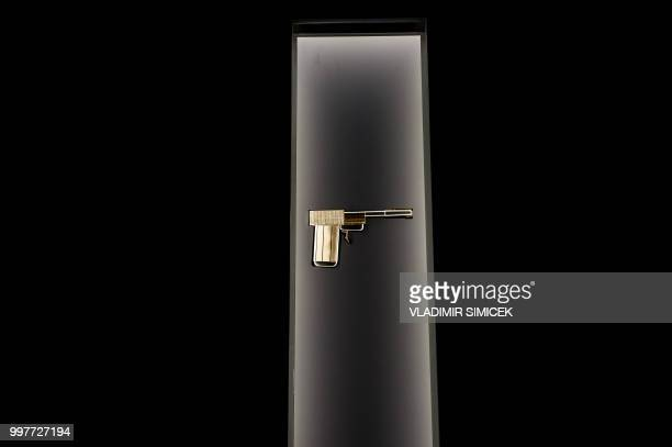 A picture taken on July 11 2018 shows the 'Golden gun' of the fictional movie character Francisco Scaramanga from the James Bond film 'The Man with...