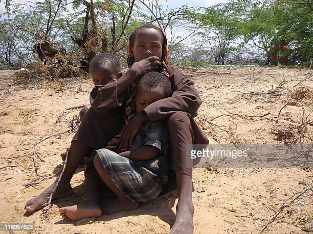 A picture taken on July 12 2011 shows Somali children sitting at a new camp in southern Mogadishu where the Somalia's transitional government has set...