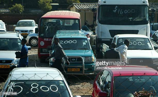 A picture taken on July 12 2012 shows secondhand vehicles at a car dealership in Harare where local authorities are facing a new headache of traffic...