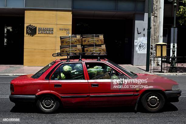A picture taken on July 12 2015 shows a car full of watermelons in central AthensThe EU cancelled a full 28nation summit on July 12 to decide whether...