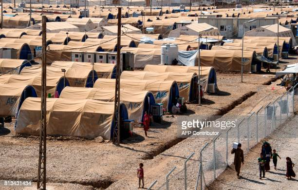 A picture taken on July 12 2017 shows a general view of the UNHCR refugee camp in Hammam alAlil on the outskirts of Mosul Iraqi Prime Minister Haidar...
