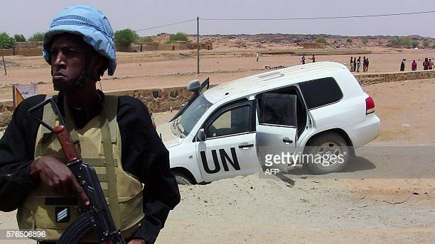 A picture taken on July 14 2016 shows a soldier of the United Nations mission to Mali MINUSMA standing guard near a UN vehicle after it drove over an...