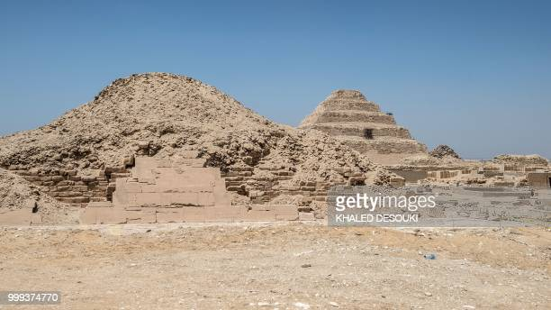 A picture taken on July 14 2018 shows a view of pyramids in the Saqqara necropolis about 35 kms south of the Egyptian capital Cairo with the King...