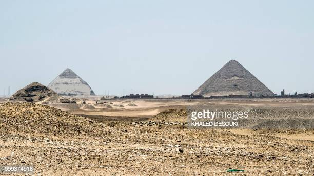 A picture taken on July 14 2018 shows a view of the Dahshur pyramids from the Saqqara necropolis about 35 kms south of the Egyptian capital Cairo...