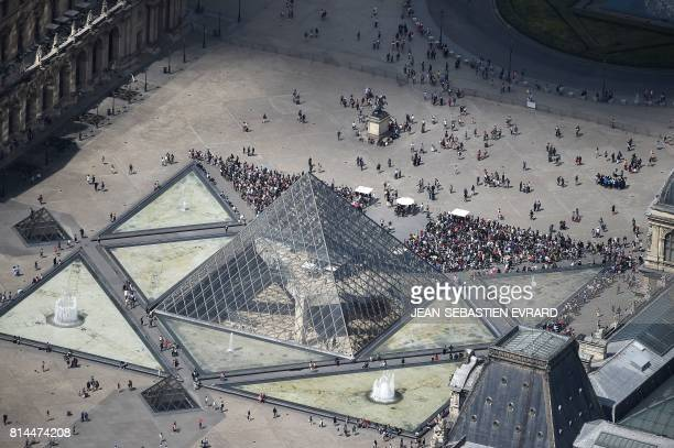 Picture taken on July 14 in Paris, shows an aerial view of the Louvre Pyramid located in the main courtyard, the Cour Napoleon, of the Louvre Palace...