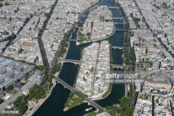 A picture taken on July 14 in Paris shows an aerial view of the river Seine and of the Ile Saint Louis and Ile de la Cite with the NotreDame Cathedral