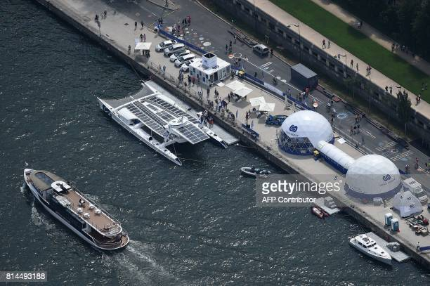 A picture taken on July 14 in Paris shows an aerial view of the river Seine with the selfenergy producing multihull 'Energy Observer' an autonomous...