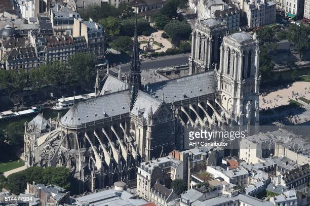 A picture taken on July 14 in Paris shows NotreDame Cathedral on the Ile de la Cite / AFP PHOTO / JEANSEBASTIEN EVRARD
