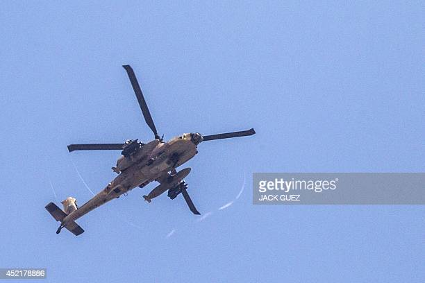 A picture taken on July 15 from the southern IsraeliGaza border shows an Israeli Apache helicopter flying over the Gaza Strip US Secretary of State...