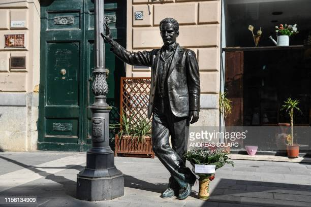 A picture taken on July 17 2019 shows the statue of Inspector Salvo Montalbano a character created by Italian writer Andrea Camilleri in the central...