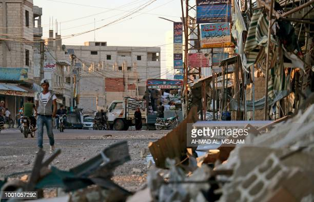 Picture taken on July 17 shows damage in a street caused by regime airstrikes, in the rebel-held town of Nawa, about 30 kilometres north of Daraa in...