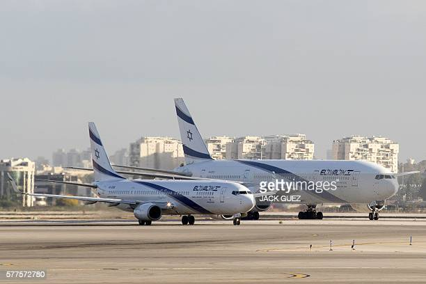 A picture taken on July 19 2016 shows an El Al Israel Airlines' Boeing 737958 and a Boeing 777258 manuvring on the tarmac at the Ben Gurion...