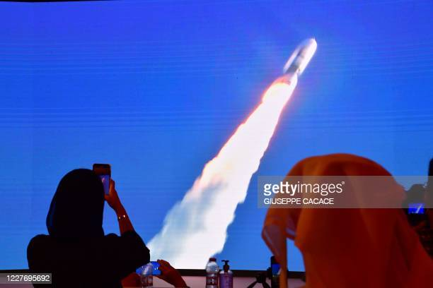 """Picture taken on July 19 shows a screen broadcasting the launch of the """"Hope"""" Mars probe at the Mohammed Bin Rashid Space Centre in Dubai. - The..."""