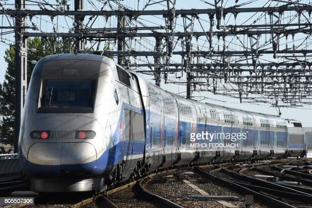 A picture taken on July 2 2017 shows the first official train of the new TGV high speed train line linking Paris to Bordeaux in 2h04 leaving the...
