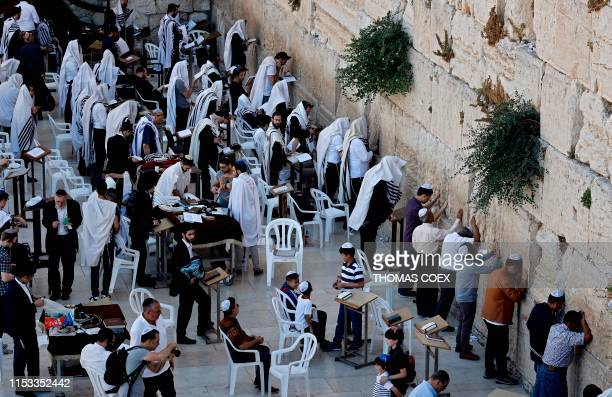A picture taken on July 2 2019 shows Jewish worshippers praying at the Western Wall in Jerusalem's Old City