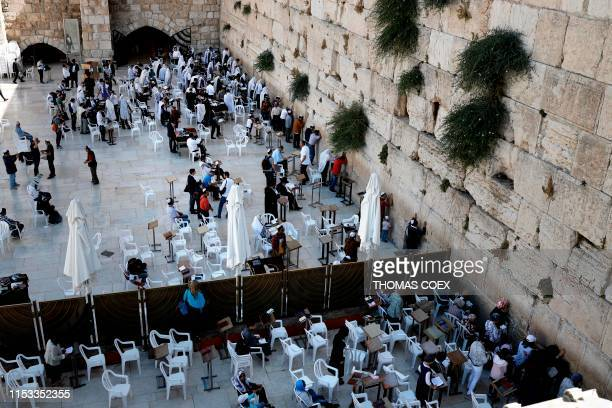 A picture taken on July 2 shows Jewish worshippers praying at the Western Wall in Jerusalem's Old City The women section is separated to the men...