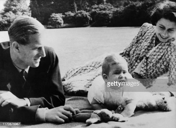 Picture taken on July 20 1949 at Windlesham Moor showing Queen Elizabeth II and Prince Philip Duke of Edinburgh with their baby Prince Charles