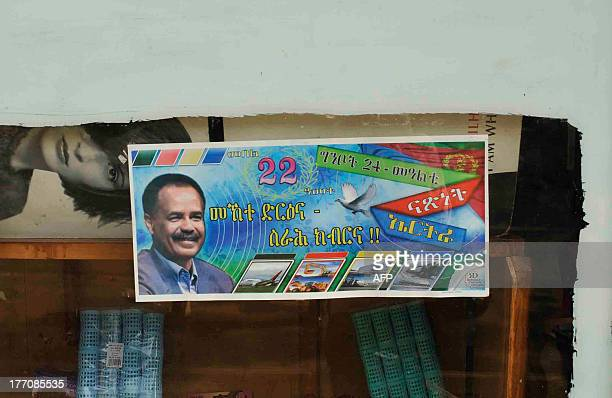 VAUGHAN A picture taken on July 20 2013 in Asmara shows a poster of Eritrean President Issaias Afewerki set on a shop window Long criticised for...