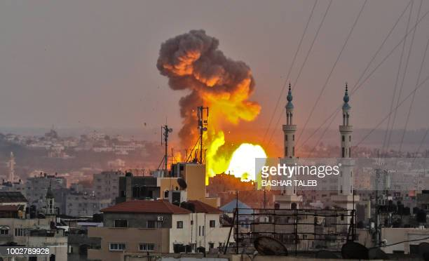 A picture taken on July 20 2018 shows a fireball exploding in Gaza City during Israeli bombardment Israeli aircraft and tanks hit targets across the...