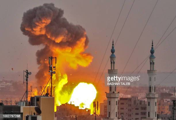 TOPSHOT A picture taken on July 20 2018 shows a fireball exploding in Gaza City during Israeli bombardment Israeli aircraft and tanks hit targets...